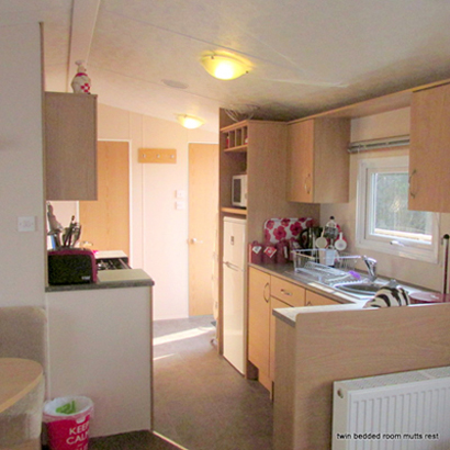 The well equipped kitchen at  Mutts Rest holiday caravan www.whiteacres-holidays-cornwall.co.uk